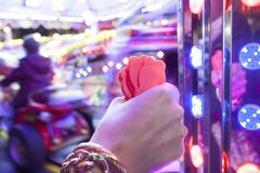 Woman hand with a fistfull of chips for fair ground ride childre Royalty Free Stock Image