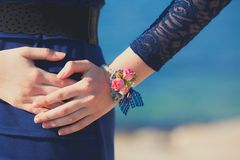 Woman hand with flower bracelet Stock Images
