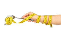 Woman hand with fork and measure tape Royalty Free Stock Photos