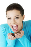 Woman with hand full of chocolates Stock Images