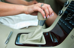 Woman hand and gearshift Stock Photos