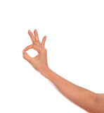 Woman hand with gesturing ok sign isolated Royalty Free Stock Images