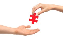 Woman hand give red puzzle to man hand Royalty Free Stock Photos