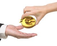 Woman hand giving currency symbol gear to man hand Royalty Free Stock Image