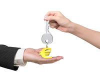 Woman hand giving key euro sign keyring to man hand Royalty Free Stock Image