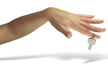 Woman hand giving the key isolated Royalty Free Stock Photo