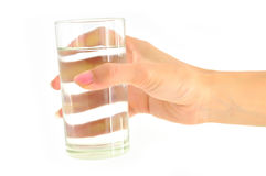 Woman hand with glass of water Royalty Free Stock Photos