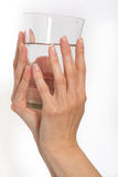 Woman hand with glass of water Royalty Free Stock Images