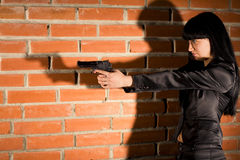 Woman With Hand Gun Royalty Free Stock Images