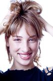 Woman with hand in hair Royalty Free Stock Image