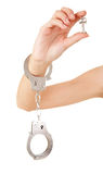 Woman hand with handcuffs and key Royalty Free Stock Photos