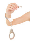 Woman hand with handcuffs and key Stock Photo