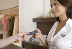 Woman hand Handing Credit Card at Counter Royalty Free Stock Photography