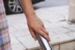 Woman hand on handrail Royalty Free Stock Photo