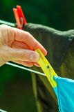 Woman hand hanging wet clothes on rope line Royalty Free Stock Photography