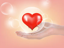 Woman Hand and heart ; bubbles on background Royalty Free Stock Photos