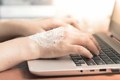 Woman hand with henna typing on laptop keyboard. Business wedding concept. Woman hand with henna typing on laptop keyboard. Business concept or woman working royalty free stock photography