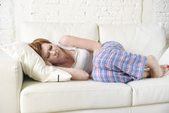Woman with hand on her belly or tummy suffering stomach cramp and period pain Royalty Free Stock Image