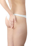 Woman with hand on her buttock Royalty Free Stock Images