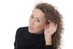 Woman with hand on her ear. Beauty woman listening you standing with hand to ear to hear better Royalty Free Stock Image