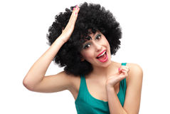 Woman with hand on her head. Young woman over white background Stock Images