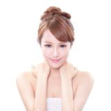Woman with hand on her shoulder. Beauty portrait of a young woman with hand on her shoulder isolated on white background, concept for health , asian beauty model Stock Photo