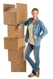 Woman With Hand On Hip Standing By Stacked Cardboard Boxes Royalty Free Stock Image