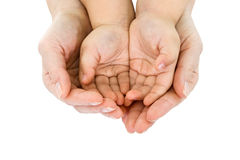 Woman hand hold a child's handful royalty free stock photo