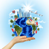 Woman hand hold Earth with buildings and airplane Stock Images