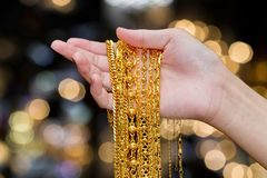 Woman hand hold gold necklace jewelry, Accessory and f royalty free stock photo