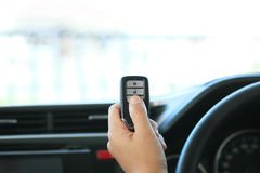 Woman hand hold a remote key car Royalty Free Stock Images