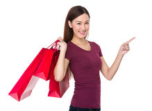 Woman hand hold with shopping bag and finger point up Royalty Free Stock Image