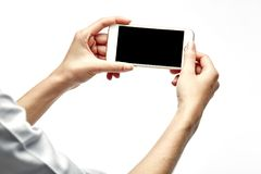 Woman hand hold and touch screen smartphone. Or cellphone isolated on white Stock Images