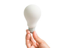 Woman hand hold a white light bulb - concept and idea - isolated Royalty Free Stock Photos