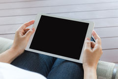 Woman hand hold white tablet Stock Image