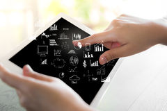 Woman hand hold white tablet with graph Royalty Free Stock Photo