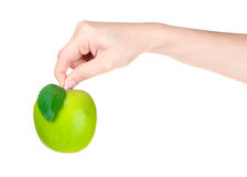 Woman hand holdig ripe organic green apple Stock Photo