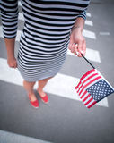 Woman hand holding american flag Stock Image