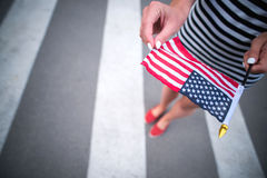 Woman hand holding american flag Stock Images