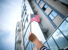Woman hand holding american flag Royalty Free Stock Images
