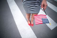 Woman hand holding american flag Royalty Free Stock Photo