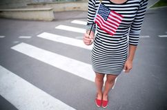 Woman hand holding american flag Royalty Free Stock Image