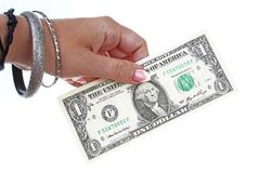 Woman hand holding american money dollar bill on isolated white cutout background. Studio photo with studio lighting. Woman hand holding on isolated white cutout stock image