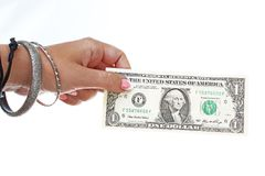 Woman hand holding american one dollar bill on isolated white cutout background. Studio photo with studio lighting easy to use for. Woman hand holding american Royalty Free Stock Image