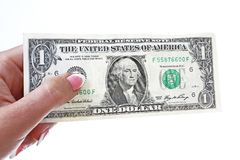 Woman hand holding american one dollar bill on isolated white cutout background. Studio photo with studio lighting easy to use for Stock Photo