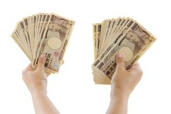 Woman Hand Holding Banknote Of 10,000 Japanese Yen Bills Isolate. D On White Background Stock Photos