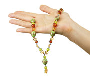 Woman hand holding beaded jewels Stock Photography