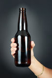 Woman hand holding beer Royalty Free Stock Photos