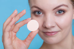 Woman hand holding big effervescent pill Royalty Free Stock Photo