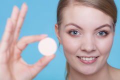 Woman hand holding big effervescent pill Stock Photography